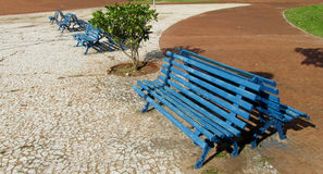 Blue wooden bench in the park Stock Image
