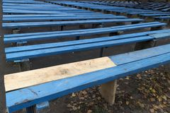 Blue wooden benches with unpainted part