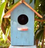 Blue wooden bird house in garden. Blue wooden bird house in the garden Stock Photos