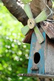 Blue Wooden Bird House with garden green blur bokeh background Royalty Free Stock Photos