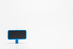 Blue wooden black board with clip on white background and selective focus Royalty Free Stock Photos