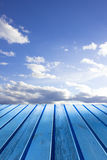 Blue wooden boards. Blue wooden table of boards on a background of bright sky Stock Images