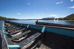 Blue wooden boats in front of Hacha falls, Canaima, Venezuela Stock Photo