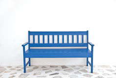 Blue wooden chair on white wall Royalty Free Stock Photos