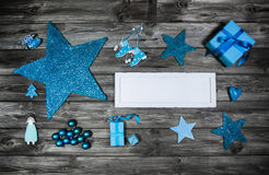 Blue wooden christmas advertising board with decoration. Stock Images