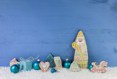 Blue wooden christmas background with Santa Claus of gingerbread Stock Photography