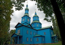 Blue wooden church with green domes Royalty Free Stock Image