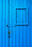 Blue_wooden_door. Blue wooden door as a background with place for advertisements Royalty Free Stock Image