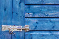 Blue wooden door background with lock Stock Images