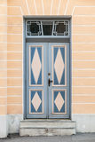 Blue wooden door with decor in old building Stock Photos