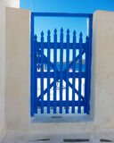 Blue wooden door in a Greek island Stock Image