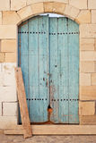 Blue wooden door of an old store in Limassol Stock Images