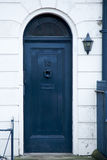 Blue wooden door with stairs part of a house Stock Images