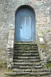 Blue wooden door and steps Stock Images