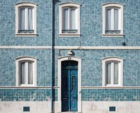 Blue Wooden Door With White Door Frame on Blue Concrete Building Stock Images