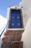Blue wooden door in white house, Santorini island, Greece Stock Images