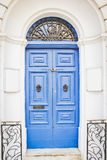 Blue Wooden Doors with Black Metal Knockers Royalty Free Stock Images