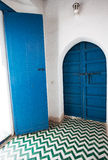 Blue wooden doors in a corner of a Moroccan palace Stock Photo