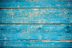 Blue wooden fence. Blue paint on old wooden fence royalty free stock image