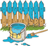 Blue Wooden Fence with Paintbrush and Tin can of Paint Royalty Free Stock Images