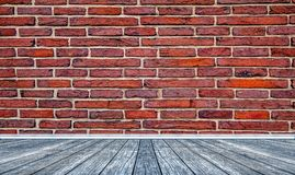 Blue flor and red brick wall Royalty Free Stock Images
