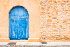 Blue wooden front door stock photo