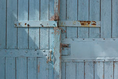 Blue wooden gate with strips from metal royalty free stock photo
