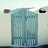 Blue wooden gates in white house, Santorini island, Greece Stock Photo