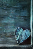 Blue wooden heart on wood royalty free stock photo