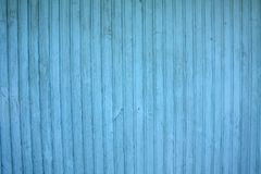 Blue color wood wall. Blue wooden house wall with vertical gloss Royalty Free Stock Photography