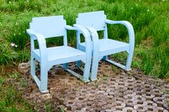 Blue wooden lawn chairs Royalty Free Stock Photos