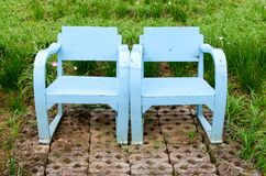Blue wooden lawn chairs Royalty Free Stock Photo