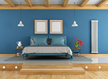 Blue and wooden master bedroom Royalty Free Stock Image