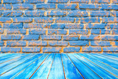 Wooden plank shelves and blue brick wall background. For pr Royalty Free Stock Photos