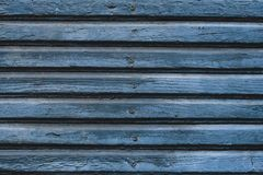 Blue wooden planks with nails. Old wood boards texture. Wooden blue fence surface. Old wooden plank background. Natural painted ta stock photo