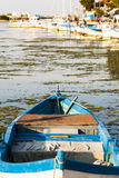 Blue wooden rowing boat. Royalty Free Stock Photography