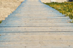 Blue wooden stairs to beach Royalty Free Stock Image