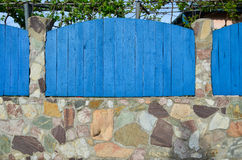 Blue wooden and stone fence Stock Photography