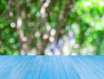 Blue wooden table with blurred background Stock Photo