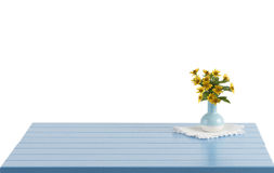 Blue wooden table with flowers in vase Stock Photos