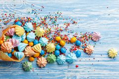 Blue wooden table full of candies, lollipops, cookies and sweet unhealthy food royalty free stock image