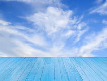 Blue wooden table with sky background Stock Photography