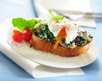 Toast with spinach and poached egg. royalty free stock photo
