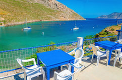 Blue wooden tables and chairs in bay, Greek Island Stock Images