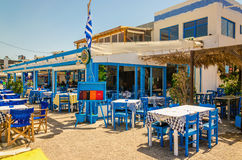 Blue wooden tables and chairs in Greek restaurant royalty free stock photography