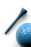 Blue wooden tee - golf ball on foreground Stock Images