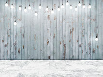 Blue wooden wall with light bulbs, background Royalty Free Stock Photography