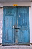 Blue wooden weathered door with padlock Royalty Free Stock Photography