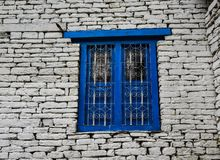 Blue wooden window with brick wall stock image
