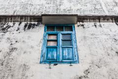 Blue wooden window and grunge wall Royalty Free Stock Image